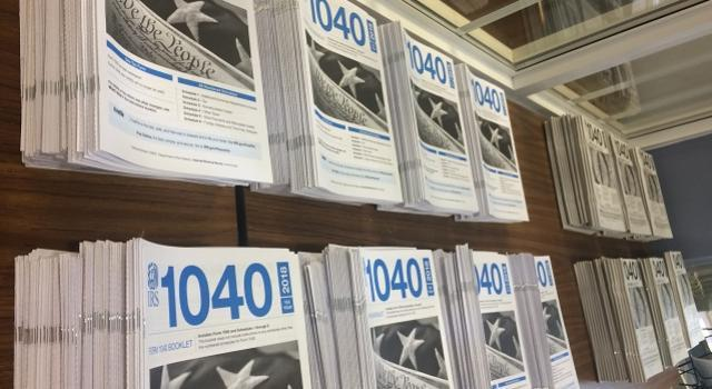 Photo of a brochure rack full of IRS Form 1040s