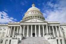 U.S. Capitol Building under blue sky.