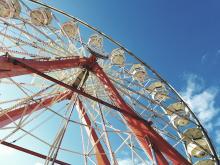Ferris wheel under blue sky.