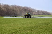 Crop sprayer on farm field