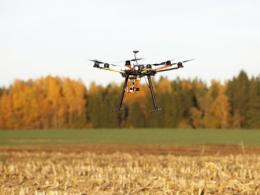 Drone flying over crop field